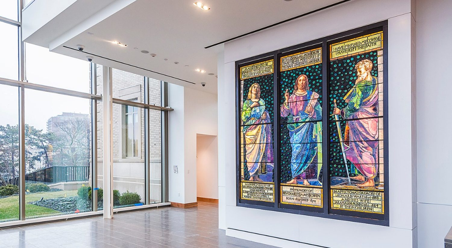 An eight-foot-tall stained-glass triptych by American artist John La Farge is the first piece to settle into the McMullen Museum of Art's new home
