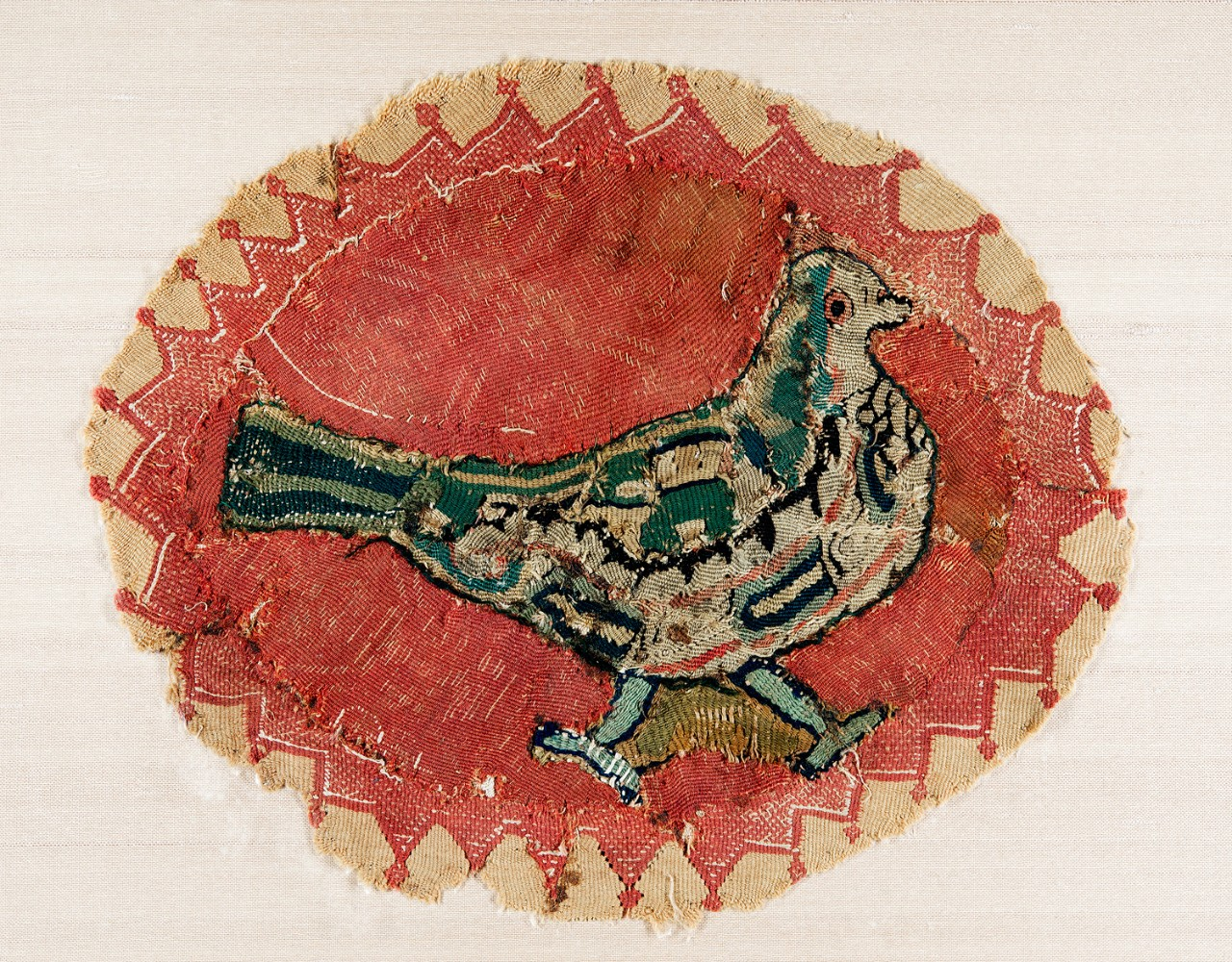 Textile roundel with dove Egypt, 5th–6th century CE wool on linen, 9 x 10.8 in.