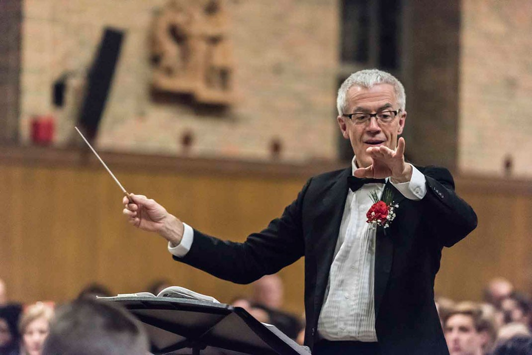 John Finney at the Christmas concerts of BC's University Chorale and Symphony Orchestra