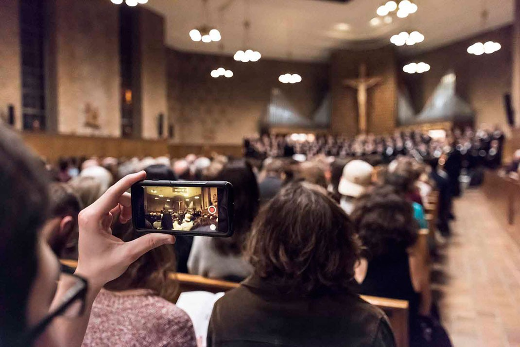 Audience view of John Finney at the Christmas concerts of BC's University Chorale and Symphony Orchestra