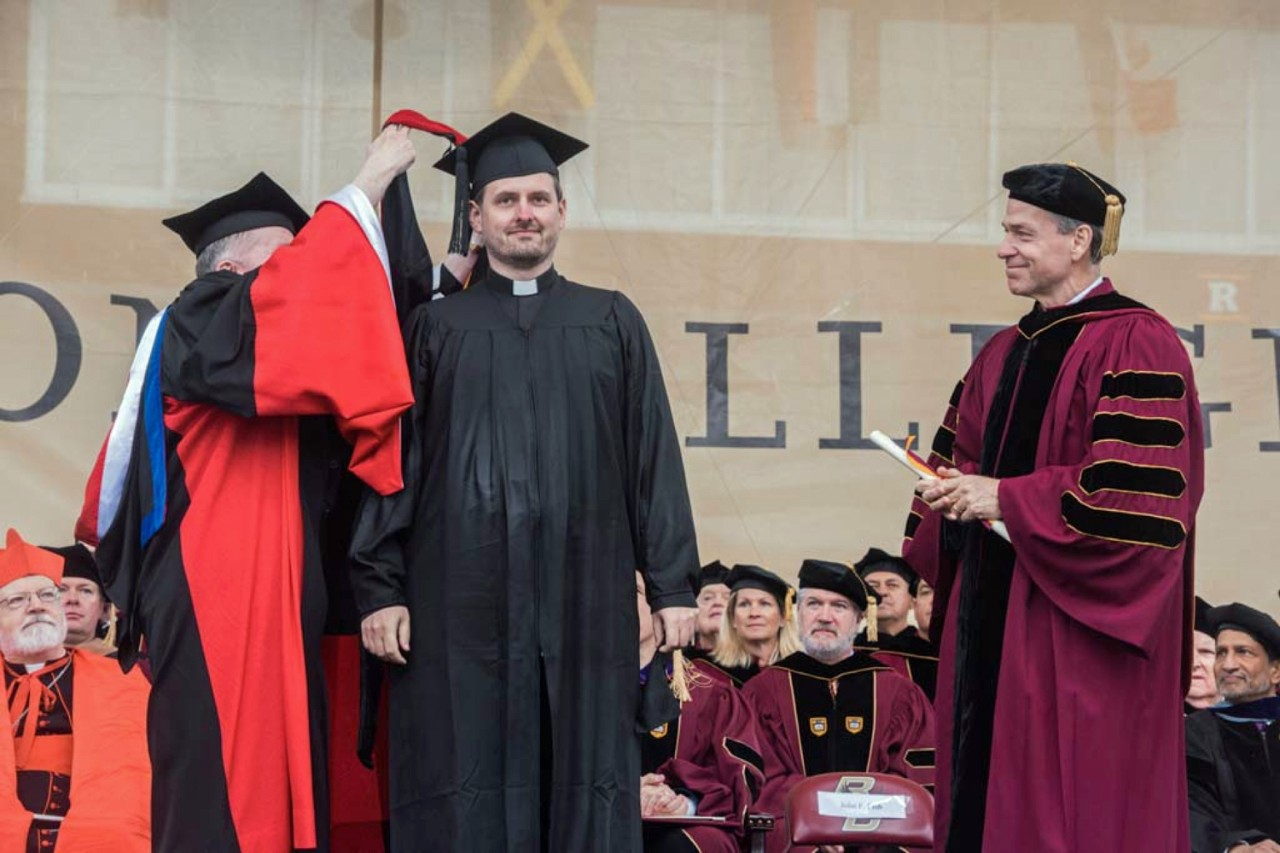Student degree presentation at Boston College Commencement.