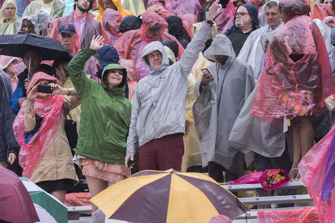 Scene from Alumni Stadium at BC Commencement; family members and friends in rain ponchos