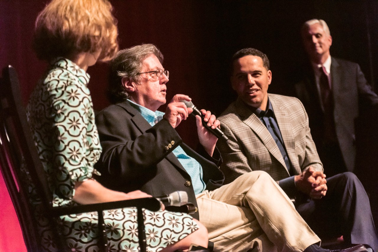 Steve Pemberton enjoys a point made by John Sykes, his former guardian and high school mentor, during a discussion following the screening. The panel included School of Social Work faculty member Tiziana Dearing and was moderated by University Communications AVP Jack Dunn.