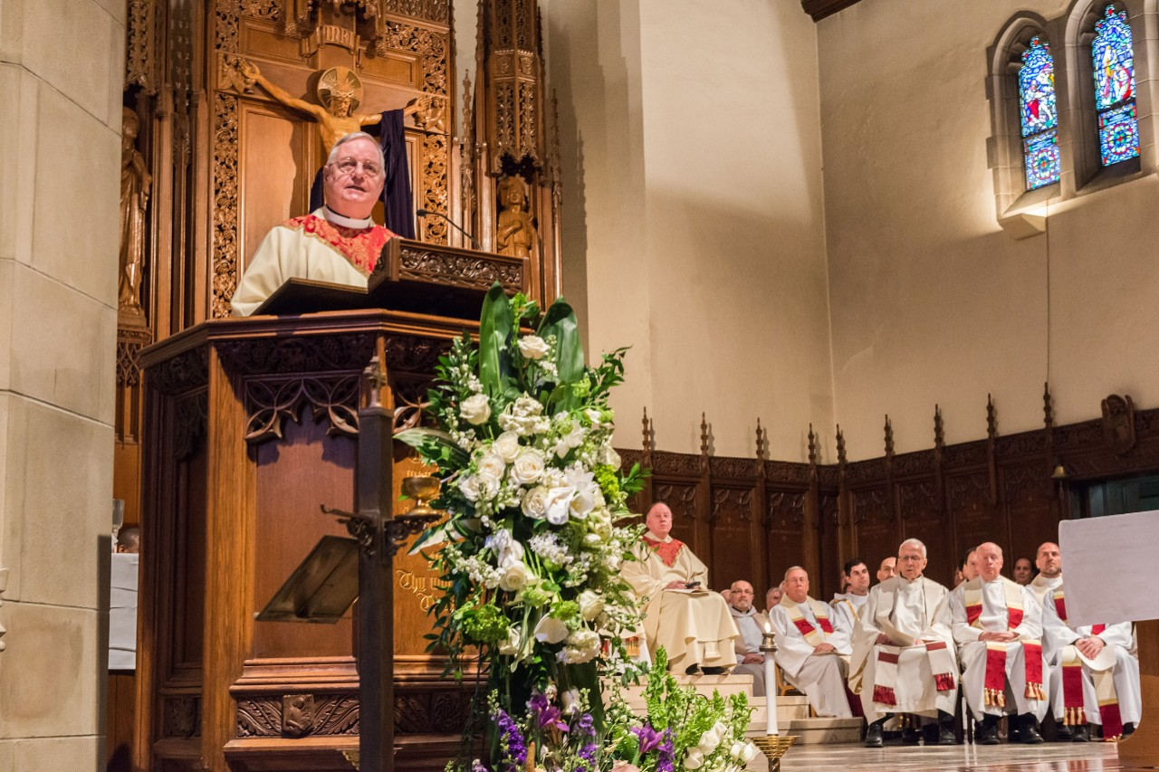 Rev. Joseph O'Keefe, S.J., delivers the eulogy for Fr. Monan