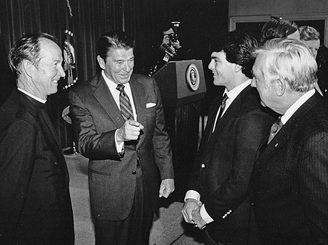 Fr. Monan, President Reagan, and Doug Flutie
