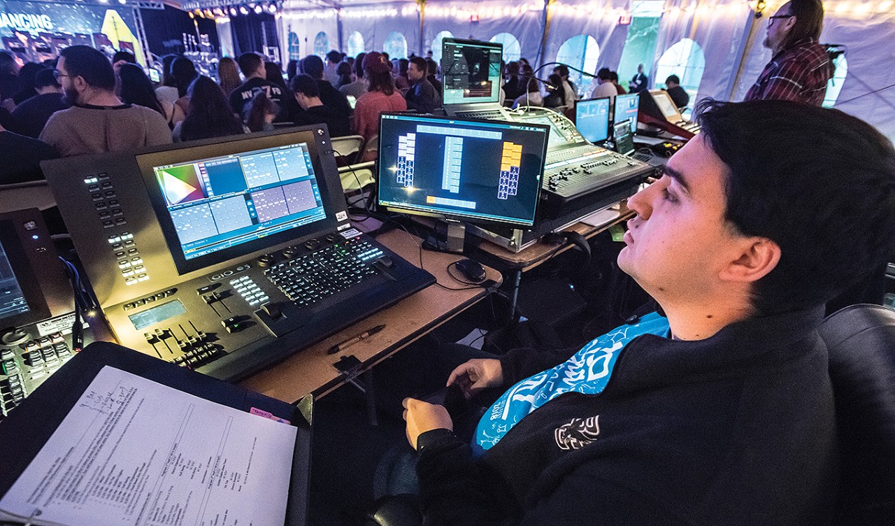 Biondolillo controls the lights during Arts Fest's Thursday night Dancing with bOp! performance in the O'Neill Plaza tent.