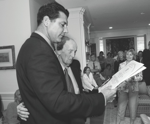 John McManama '37, MD, receiving a citation from Massachusetts Rep. Peter Koutoujian at a 2006 Boston College reception honoring Dr. McManama – who had recently turned 90 – for his years of work with University Health Services.