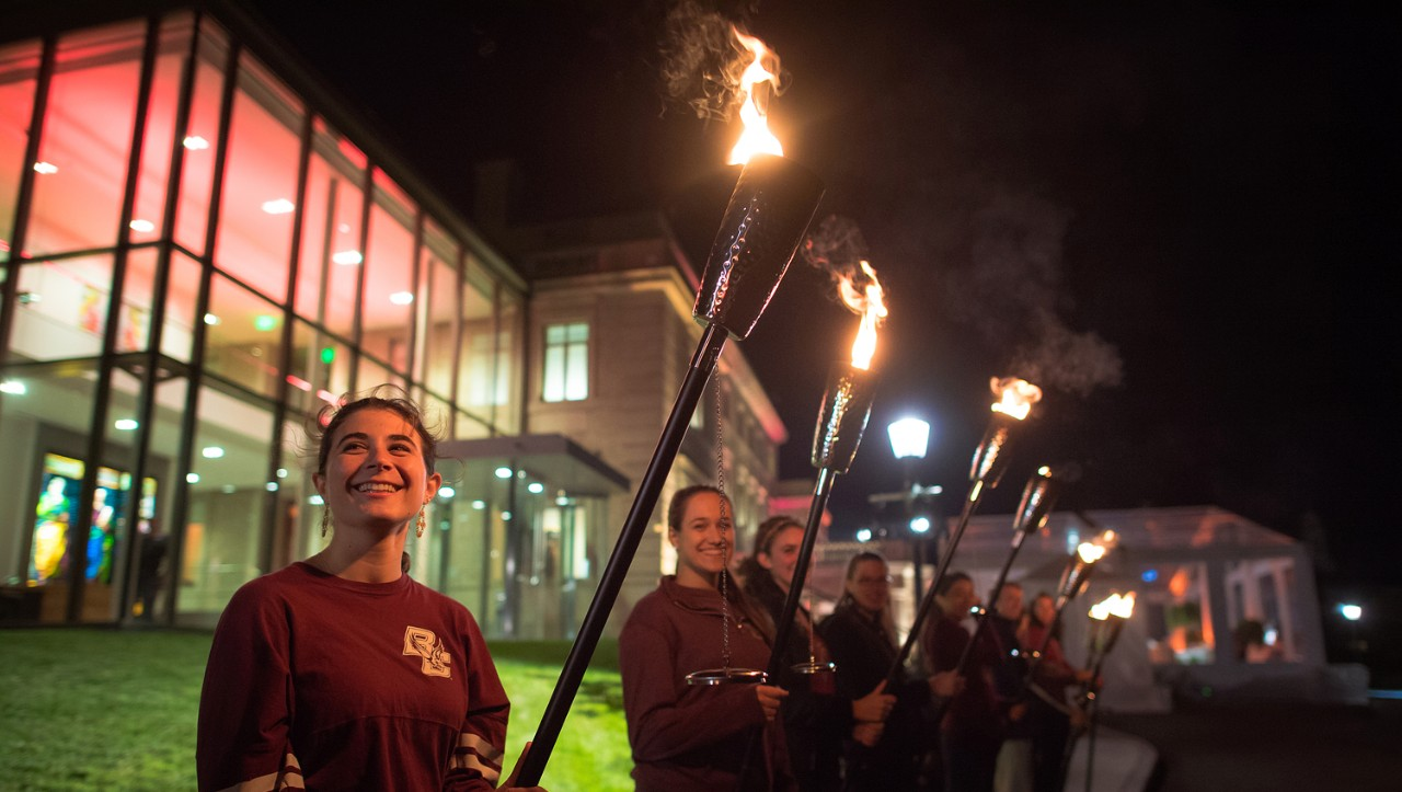 Students bearing torches to symbolize the 'Light the World' effort.