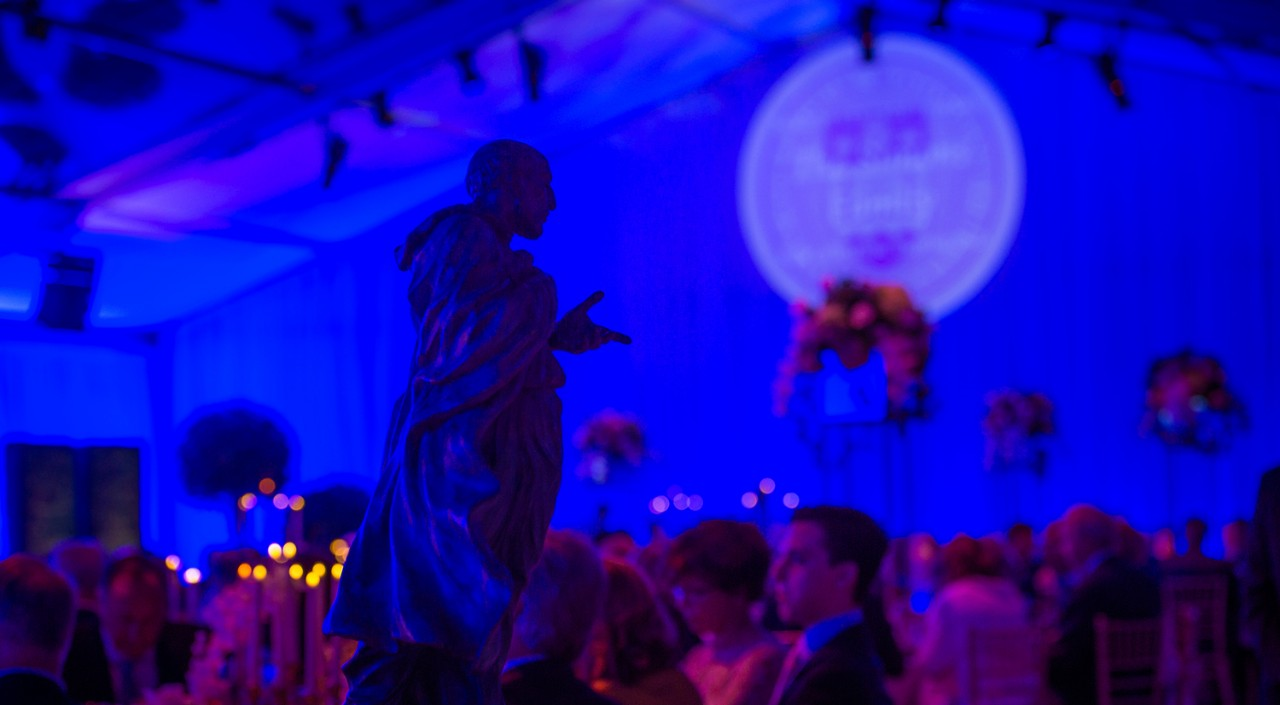 A statue of Society of Jesus founder St. Ignatius Loyola overlooked the gala venue.
