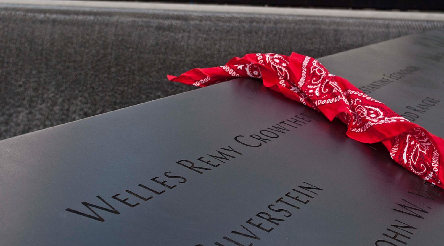 A red bandanna beside Welles Crowther's name on the 9-11 memorial