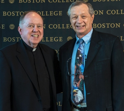 University President William P. Leahy, S.J., with Associate Professor of Sociology Michael Malec, at the presentation of BC's 2016 Community Service Award. (Photo by Lee Pellegrini)