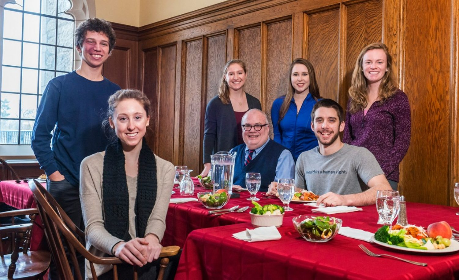 "A group of BC undergraduates with Fr. Mark Massa, S.J., at a ""Lunches with Jesuits"" event"