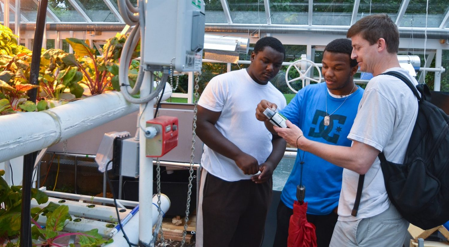 Boston College Professor of Science Education Mike Barnett (r) and colleagues report a number of positive results for students who participated in an afterschool science enrichment curriculum they developed using hydroponic gardening techniques.