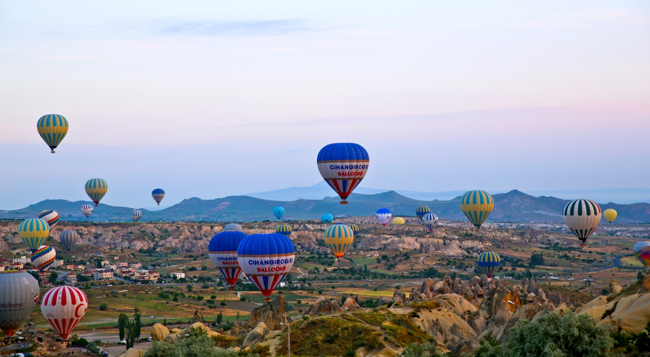 Hot air balloons take flight at dawn above Cappadocia, in central Turkey