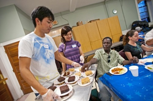 Student serving desert at event
