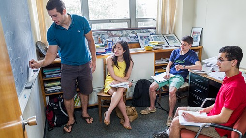 Professor John Baldwin and students work on a math problem