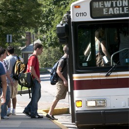 Student boarding the BC Shuttle bus
