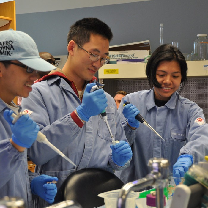 students in lab gear