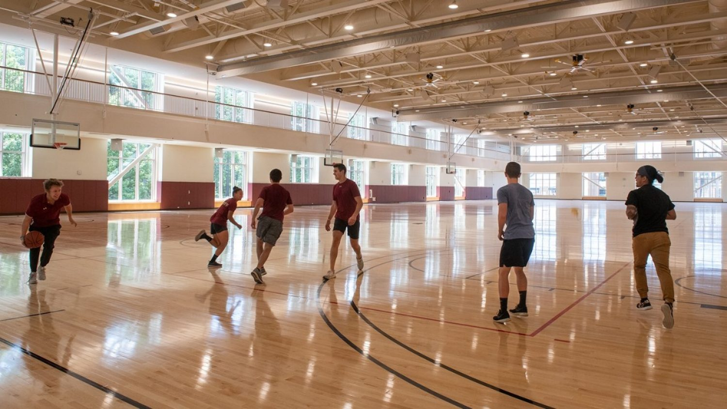 A group of students plays basketball on the new Recreation Center courts