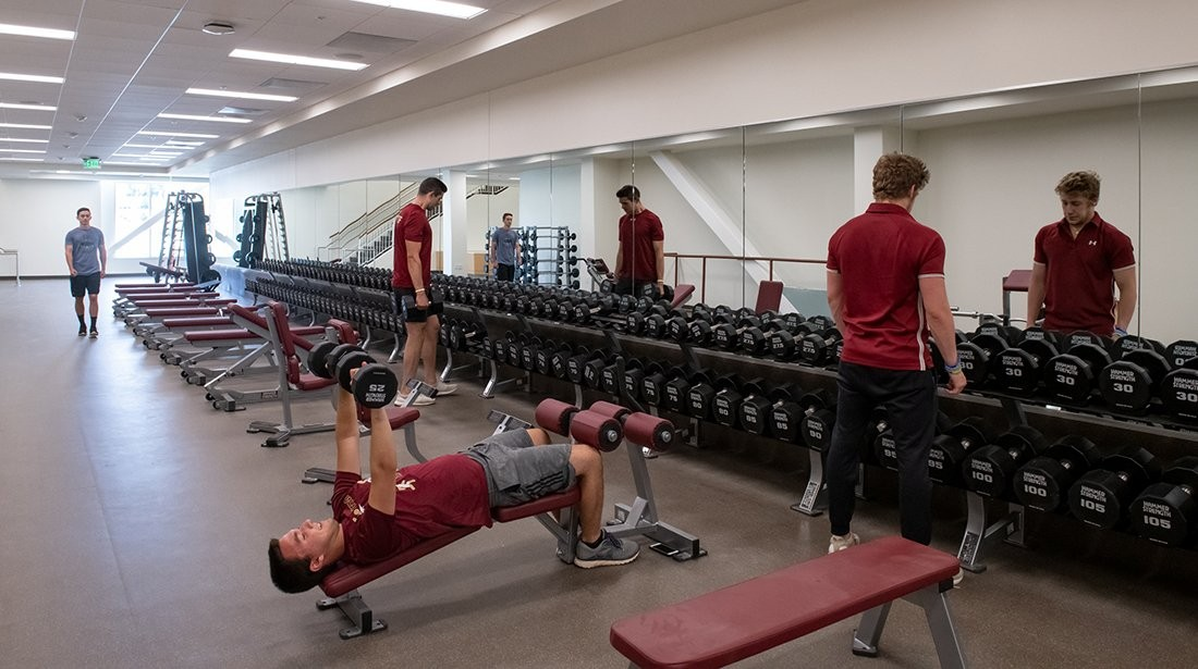 Students using free weights