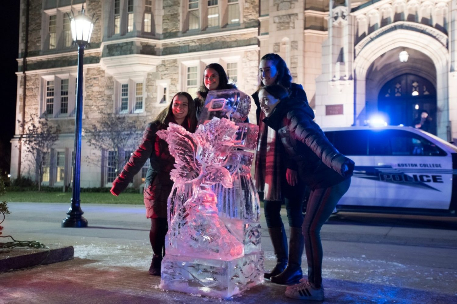 Students with an ice sculpture