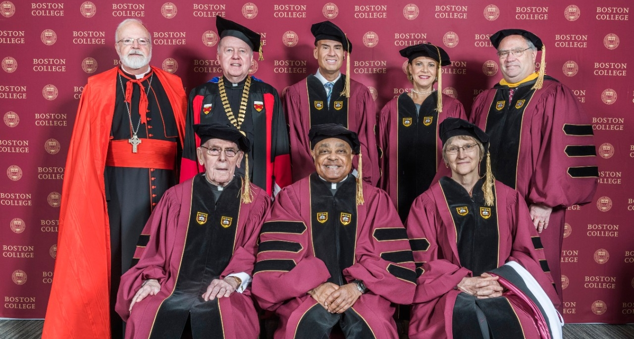 L-R (standing): Cardinal Seán O'Malley, OFM., Cap. archbishop of Boston; Boston College President William P. Leahy, S.J.; El Mundo Boston President and CEO Alberto Vasallo III '89; HBO documentary producer Kendall B. Reid '79; Boston College Board of Trustees chair Peter K. Markell '77; (seated) retired Boston College administrator Joseph Duffy, S.J., '50, MA'51, STL'58; Archbishop of Atlanta Wilton D. Gregory; Harvard University President Drew Gilpin Faust. (Gary Wayne Gilbert)