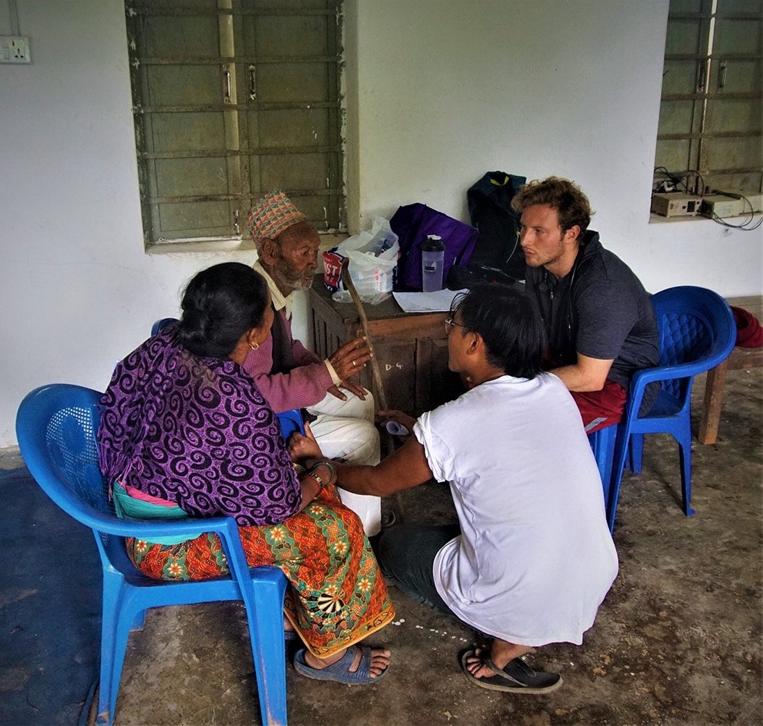 Rizzuto meeting with villagers in Nepal.