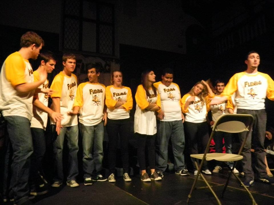 A group of improv actors standing on stage