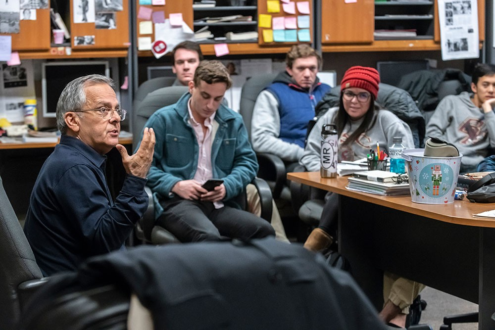 Mike Lupica visited with staff members of The Heights