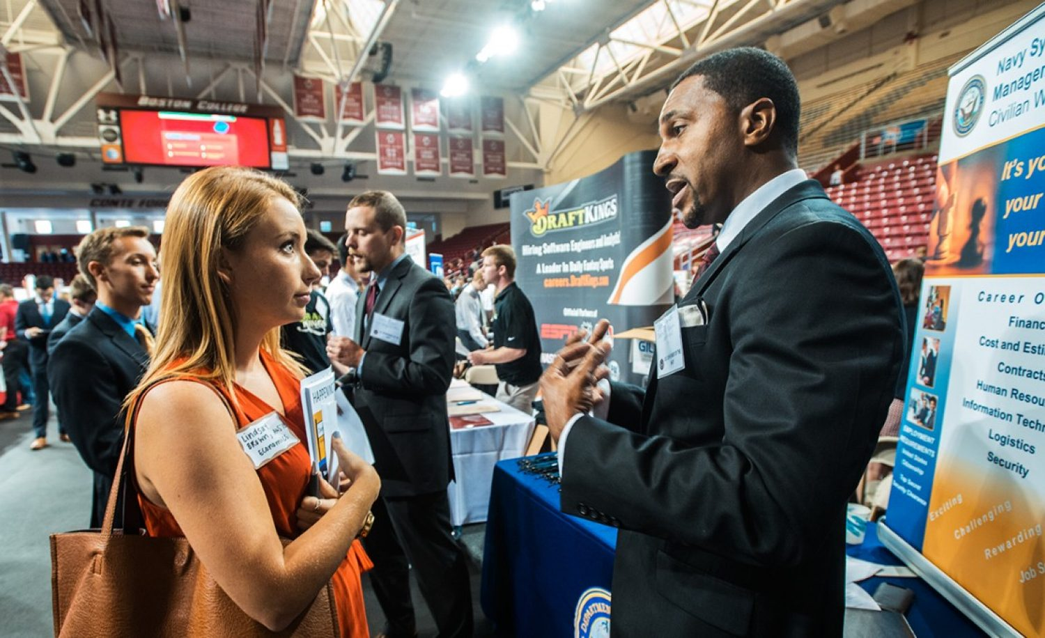 Two people shaking hands at a career fair