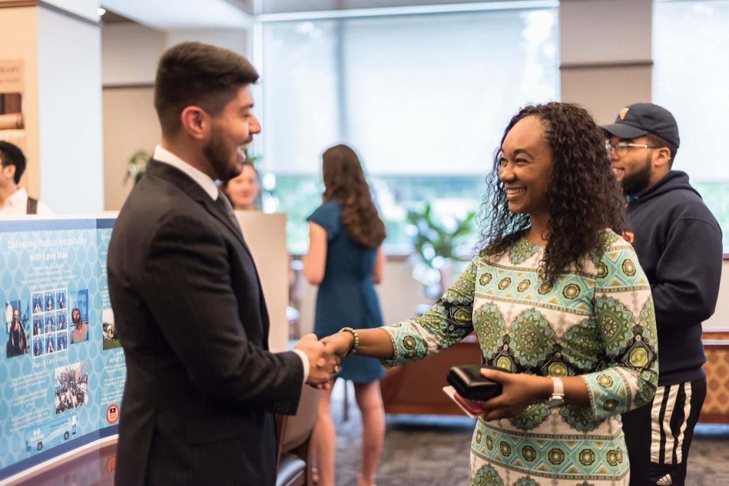 Thea Bowman AHANA and Intercultural Center Director Ines Maturana Sendoya congratulated David Jasso '20 at a presentation/reception event for participants in the Eagle Intern Fellowship Program. (Photo by Yiting Chen)