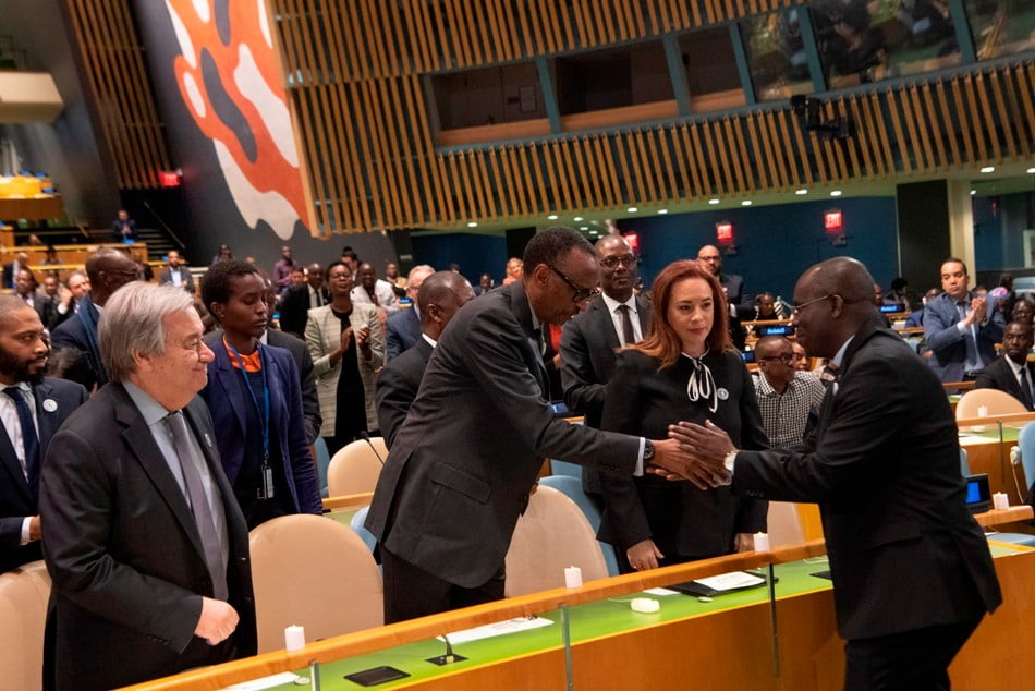 Paul Kagame and Fr. Marcel Uwineza greet each other at the UN.