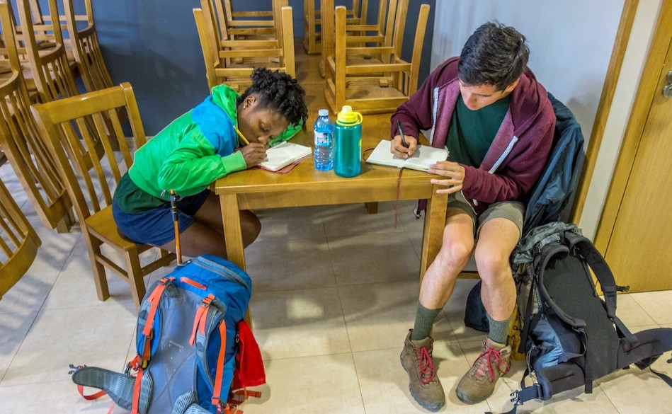 Arnesia Banks '16 and Holterman write in their journals