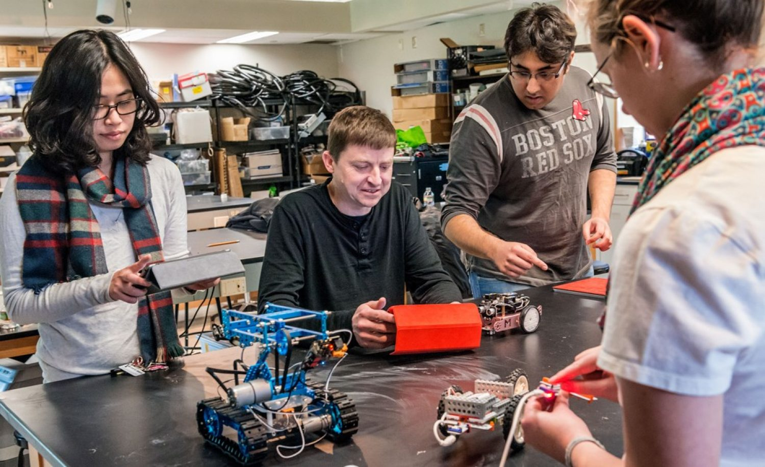 Michael Barnett working with students on a robotics project | Photo by Gary Gilbert