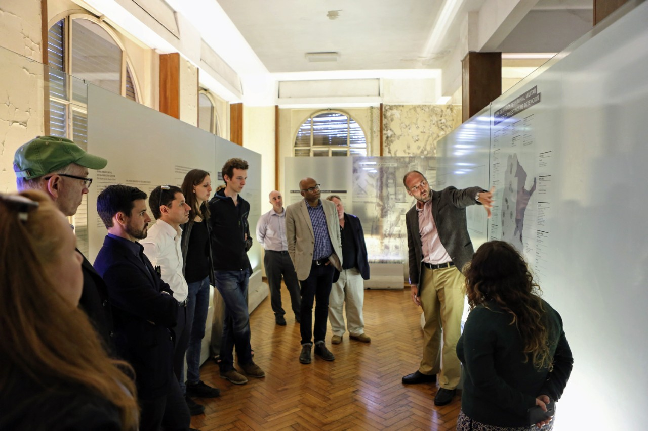 "Associate Professor of Sociology Gustavo Morello, S.J., discusses the history of Argentina's brutal military dictatorship during a tour of the memorial museum known as ""Ex-ESMA."""