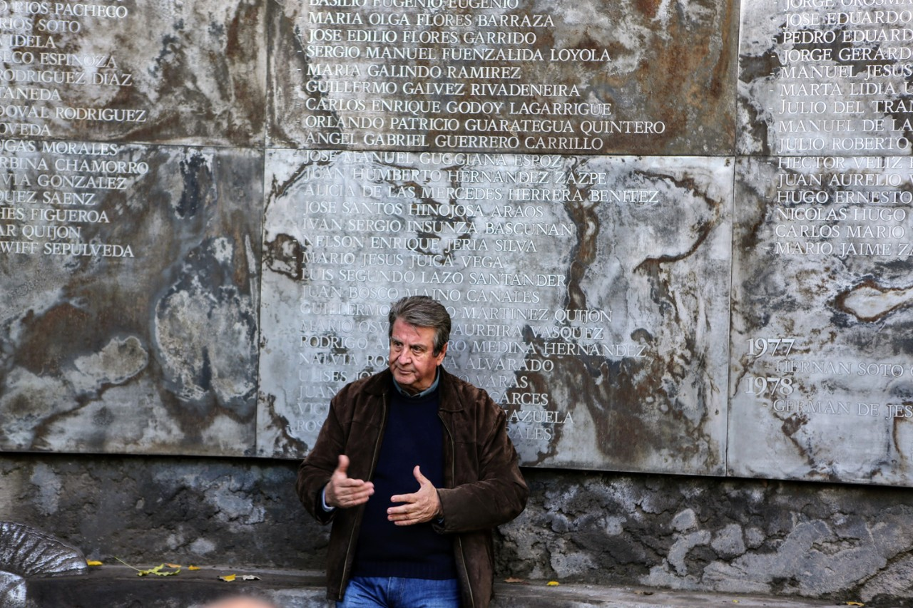 A memorial wall honors victims at the site of a former detention center known as Villa Grimaldi, Santiago, Chile. Pictured: Memorial tour guide Pedro Matta, who was detained in 1975 and held and tortured at the site for 16 months.