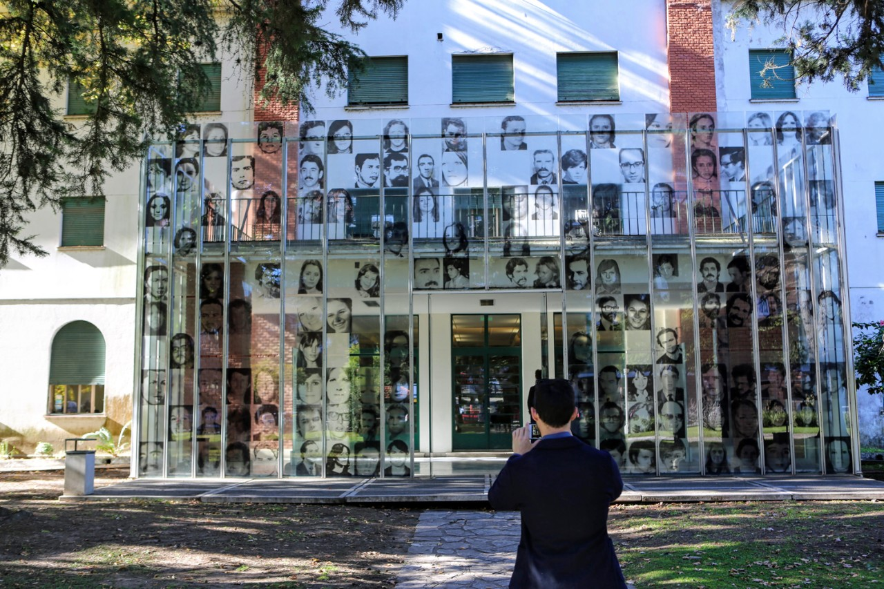 Assistant Professor of the Practice of Philosophy David Storey takes a picture of the entrance to a memorial museum located in buildings that once housed a detention and torture center on the site of Argentina's former naval academy near downtown Buenos Aires.