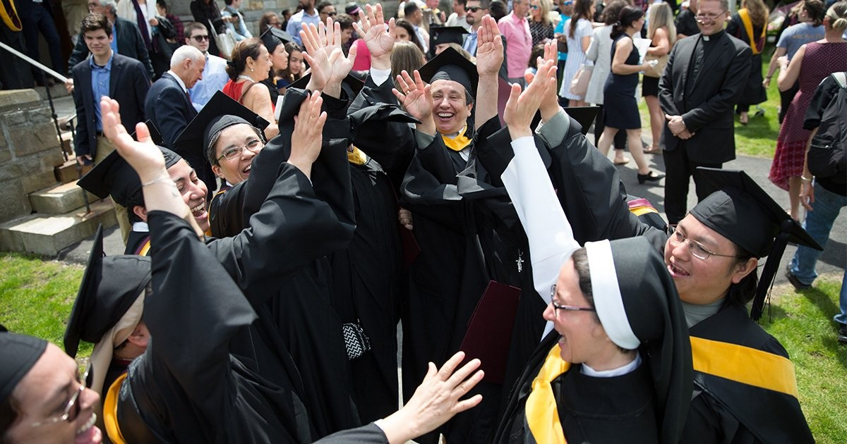 Women religious in cap and gown