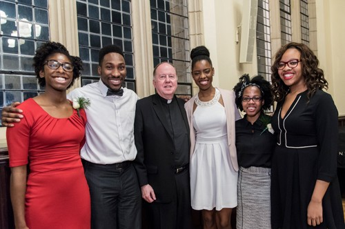 MLK Scholarship winners posing with Father Leahy