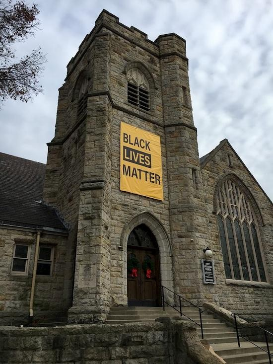 black lives banner on building