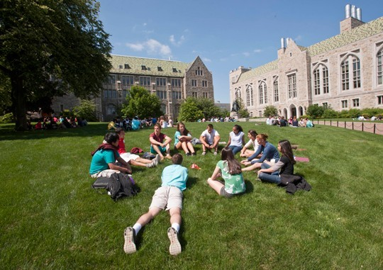 Students laying on the lawn