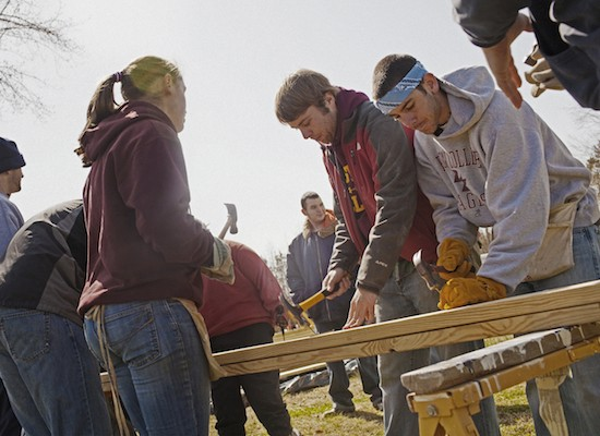 Students building a house