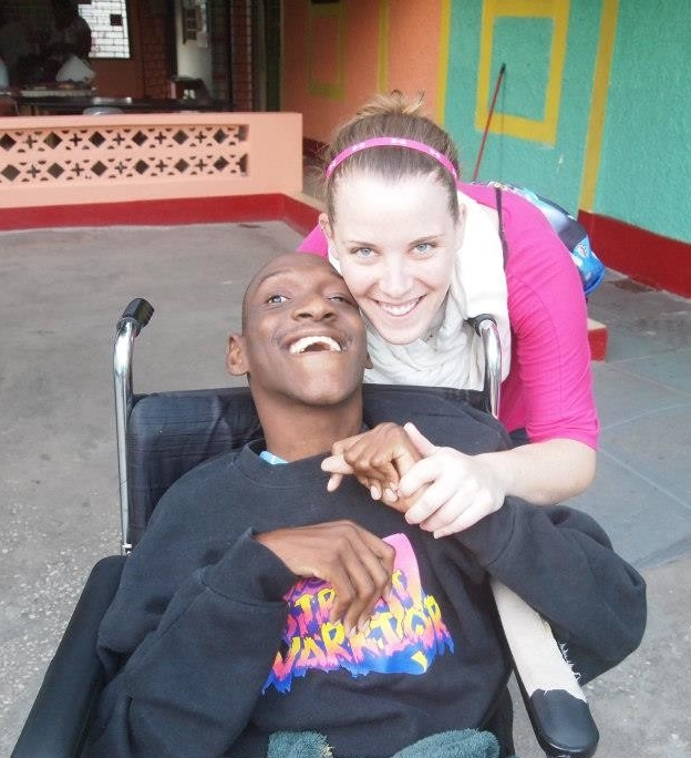 Picture of Betsy with male student in wheelchair
