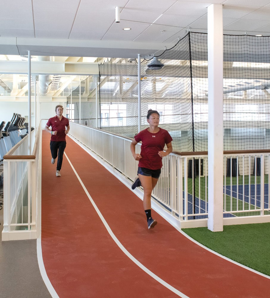 elevated track with two men running