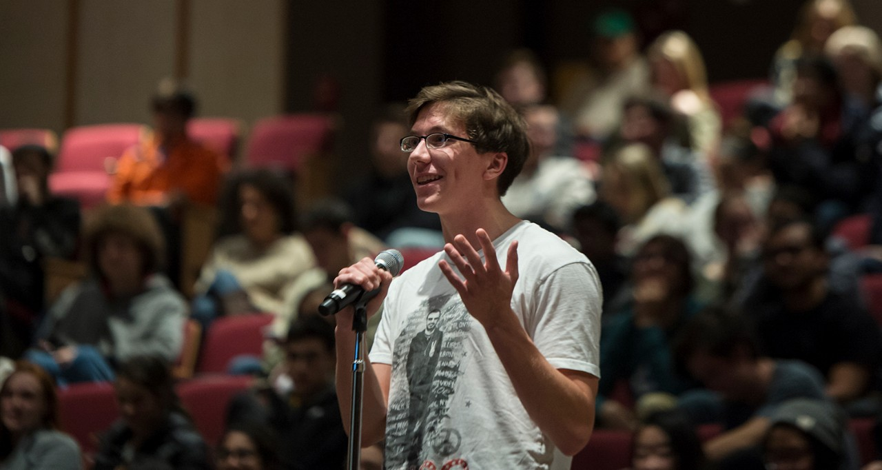 A student asks a question at a Winston Center event