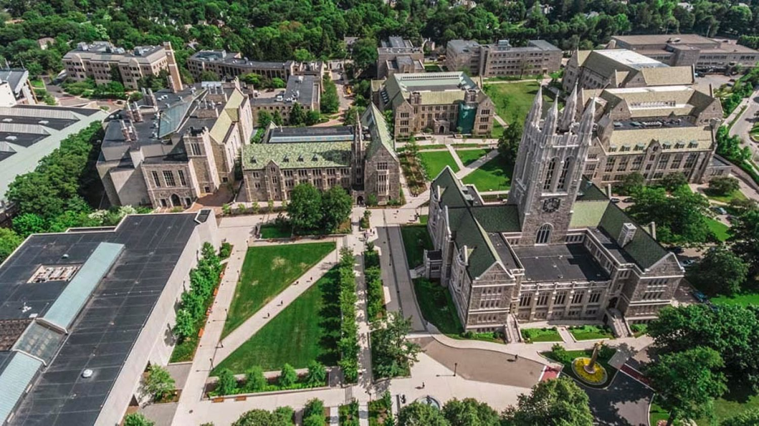 Aerial view of Boston College's campus with students crossing the quad