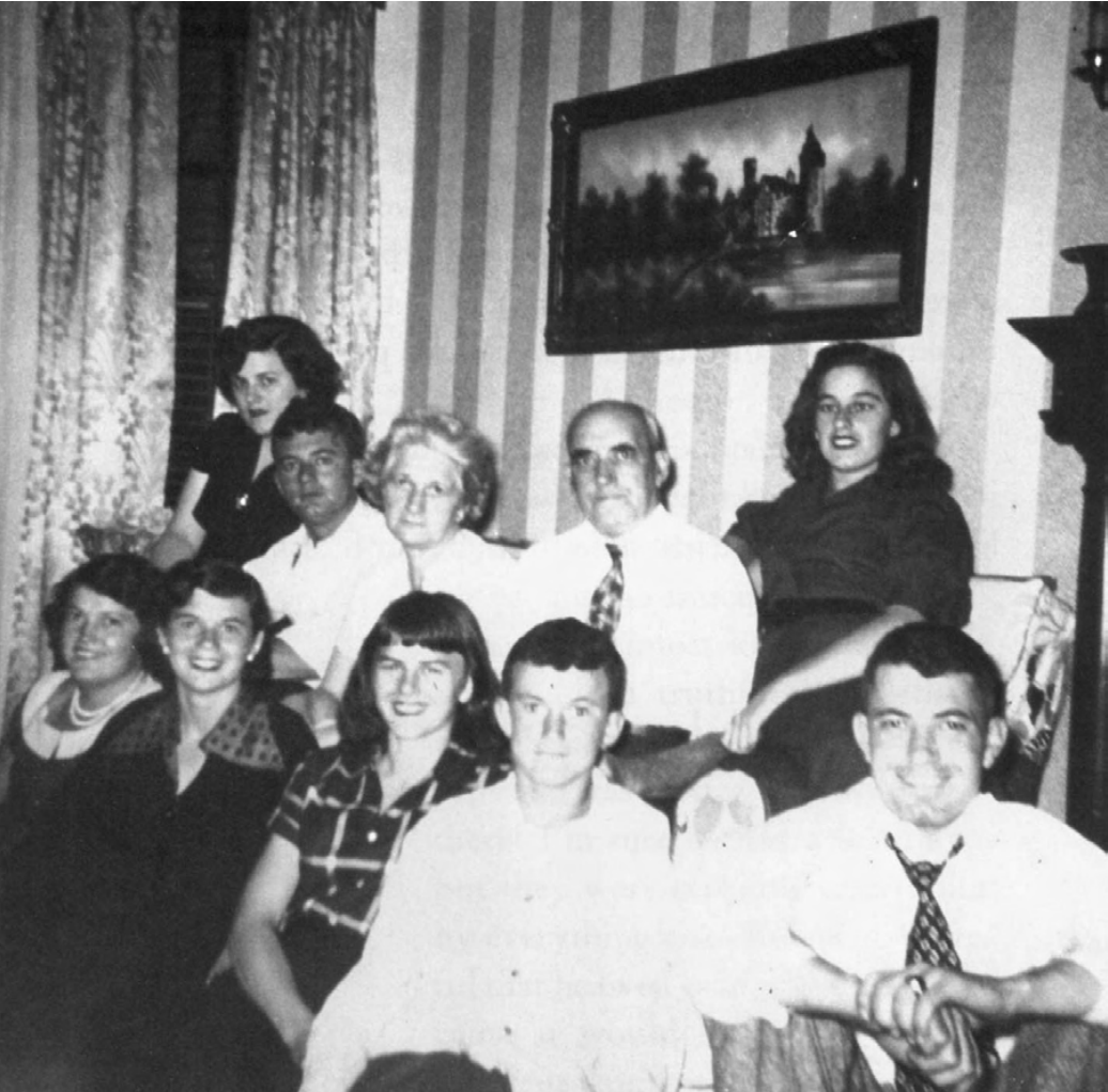 Black and white photo of the Corcoran family with all eight siblings