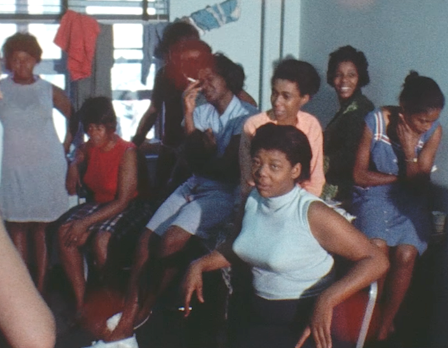 A group of black women in a old color film photo