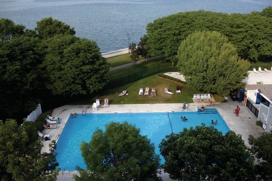 Aerial photo of children playing in the Harbor Point on the Bay outdoor pool overlooking the Boston Harbor