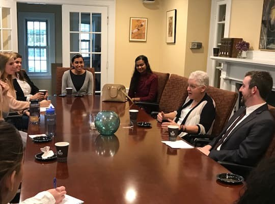 Students at a table discussion with Gina McCarthy, 2018